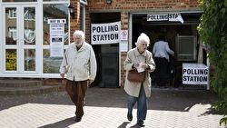 Two elderly British citizens leaving a polling station
