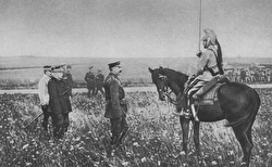 Lord Kitchener in a field talking to a man on horseback