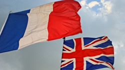 Union Jack and Tricolore flags in the wind