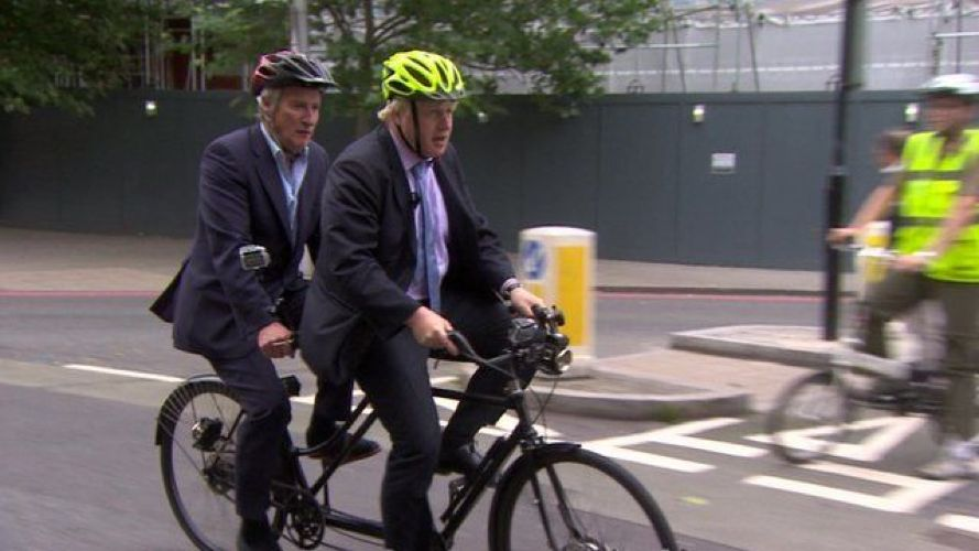 A photo of Jeremy Paxman and Boris Johnson riding a tandem bike together
