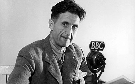Photo of George Orwell in front of a BBC radio micrphone