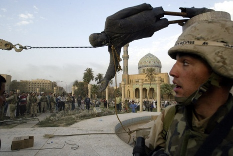 Photo of Saddam Hussein's statue in Baghdad being torn down by civilians and US soldiers
